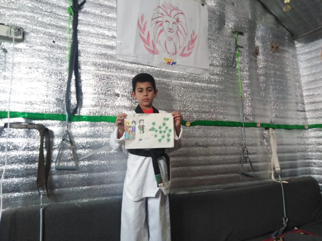Ayoub holding the drawing